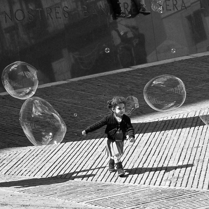 Girl playing with giant bubbles